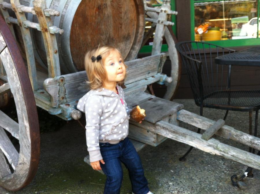Ellie next to a wine barrel
